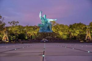 Peace Statue in Nagasaki Peace Park, Nagasaki, Japan photo