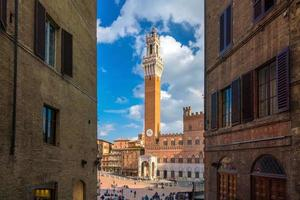 Crowd of people in Piazza del Campo square in Siena photo
