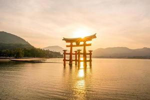 The floating gate of Itsukushima Shrine at sunset photo