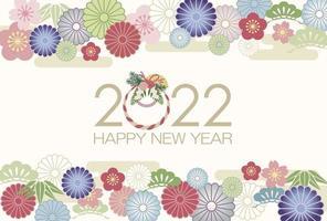 Plantilla de tarjeta de felicitación 2022 decorada con encantos vintage japoneses. vector