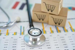 Stethoscope and shopping cart logo on box with graph photo