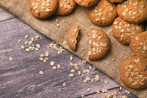stack of whole meal cookies on wooden background photo