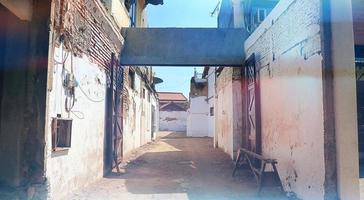 Quiet Inner City Alley Background at noon photo