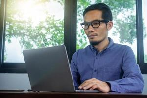 Man using computer work at home photo
