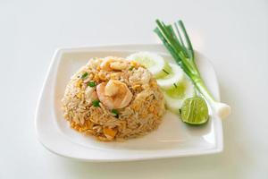 Fried rice with shrimps and crab on white plate photo