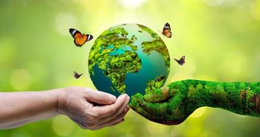 Concept Save the world save environment The world is in the grass photo
