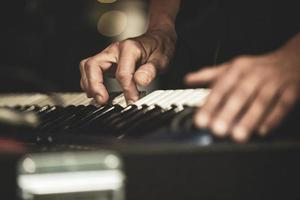 hands of musician woman when playing the sinth photo