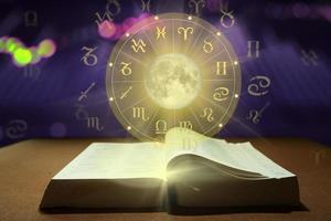 Book of Zodiac sign wheel of fortune. Astrology concept. photo