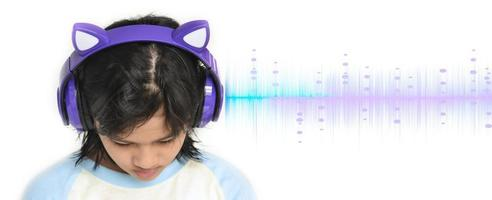 A young girl listening to the music photo