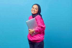 Photo of women Asia hold laptop wear pink sweater. pink background