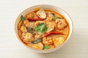 Spicy boiled pork soup with mushroom - Tom Yum - Asian food style photo