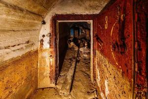 Rusted metal armored door in old abandoned dirty Soviet bunker photo