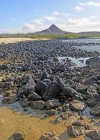 Volcanic Peak on a Remote Island Shore photo