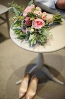 Bridal Flower and High Heeled Shoes photo