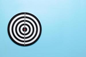 Dart target board on blue background photo