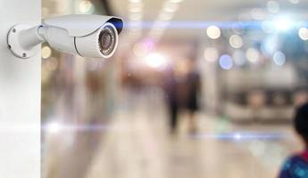 CCTV camera on a wall white photo