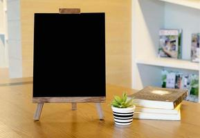 A small blackboard rests on the desk. photo