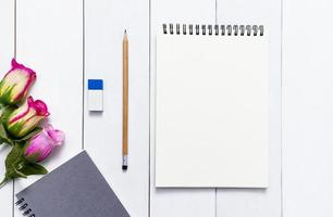 Notebook for mock up with on white wood table background photo
