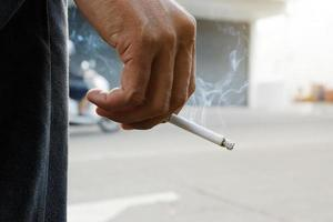 Men holding Smoking cigarettes photo