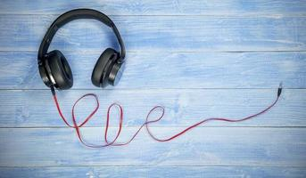headphone and cable on Blue wood table background. photo