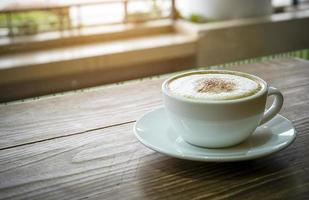 Coffee Cup on grunge wooden background photo