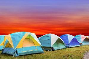 tourist tent with beautiful sunset background photo
