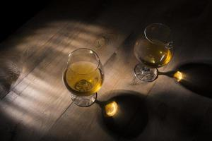 A glass of brandy on a wooden background photo