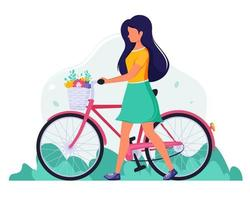 Woman with a bike with flowers in the basket. vector