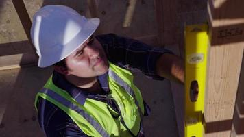Construction worker checking a level video