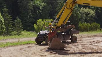 Construction workers driving utility vehicle on job site video