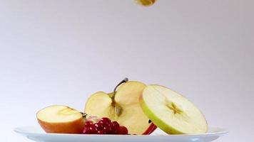 Happy Rosh Hashanah. Pouring honey on apples on white background. video