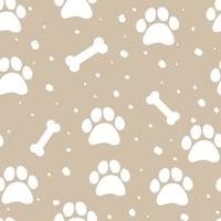 Seamless pattern with bones and paw prints of animals vector