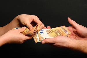 People count money, counting euro bills by man and woman, photo