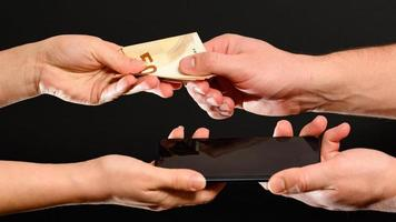 Sale and purchase of a mobile phone, retail, payment for goods photo