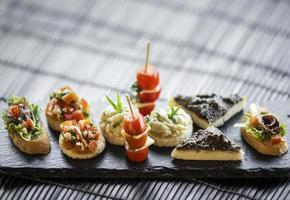 Spanish gourmet creative tapas mixed snack platter set on table photo