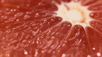 Macro of rotating ripe grapefruit slice video