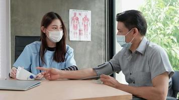 Doctor checks the health of handicapped man. video