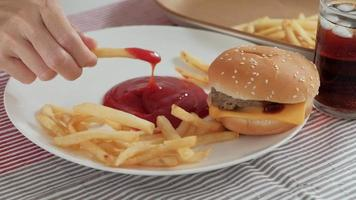 Eating fast foods on the white dish. video