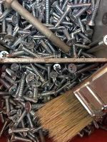 reparar herramientas de equipo como tornillo de clavo foto