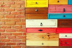 Colorful Wooden Drawer and Brick Wall photo