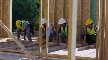 Group of construction workers standing up wall video