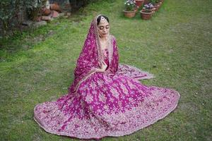 indian bridal in red lehnga photo