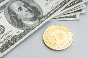Dogecoin coin on dollar banknotes photo