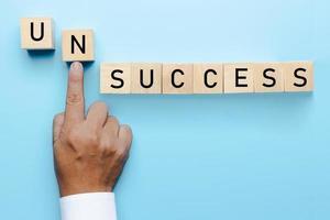 Unsuccess to success concept, hand of businessman push problem photo