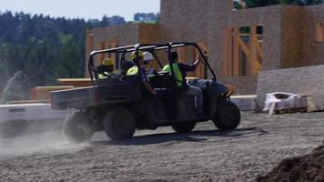 Construction workers driving utility vehicle to job site video