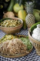 Mixed Cambodian vegetables on traditional restaurant buffet table in Siem Reap with shredded banana blossom in foreground photo
