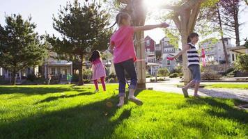 Children blowing bubbles at park, slow motion video