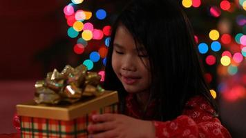 Young girl opens opens Christmas present video