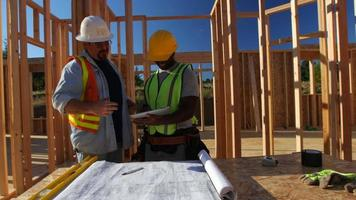 Construction workers using digital tablet on job site video