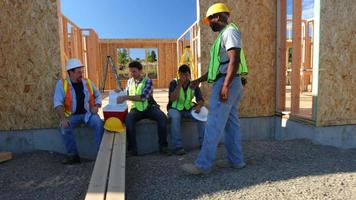 Group of construction workers taking a break video